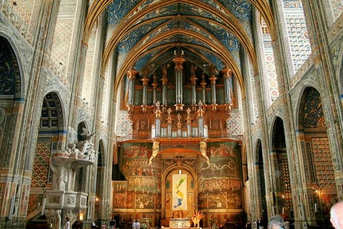 Die Wandgemälde im Chorschiff erinnern an eine düstere Zeit. Foto: © CDT du Tarn C. Rivere